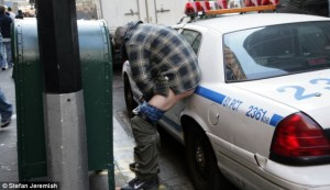 New York protestor defectates on a police car.